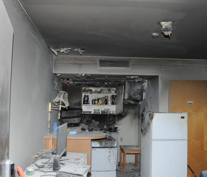 Aftermath of a fire in kitchen soot damage throughout